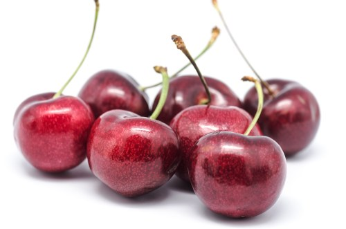 macro photograph of some cherries on white background